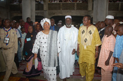 President Sirleaf is escorted in the Mosque by Sheik Abubarka and Public Works Minister Dunzo.