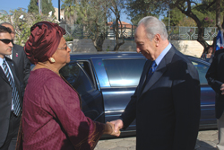 President Sirleaf is greeted by President Peres upon her arrival.
