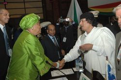 President Sirleaf is greeted by the Libyan leader Muammar Gaddafi.