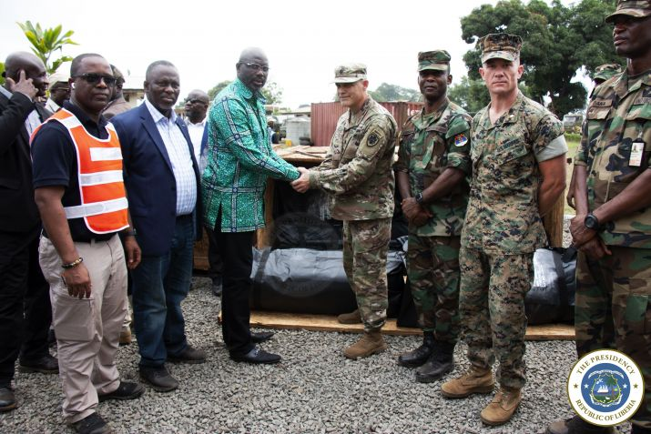 An officer of the US Military presenting tarpulins to President Weah for use by the Armed Forces of Liberia