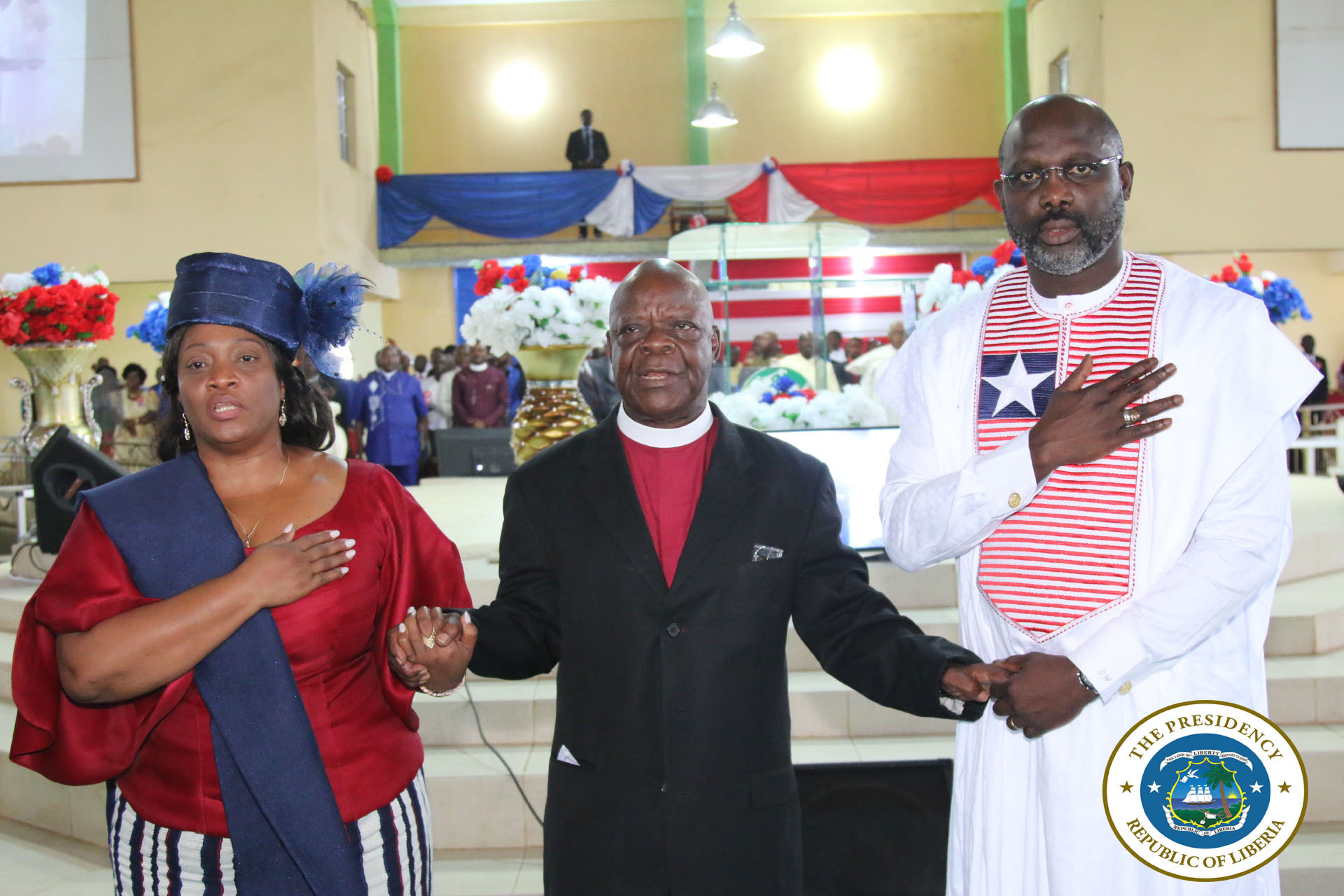 Bishop Arthur Kulah praying for President Weah and VP Howard-Taylor at the Independence Intercessory Service in Johnsonville