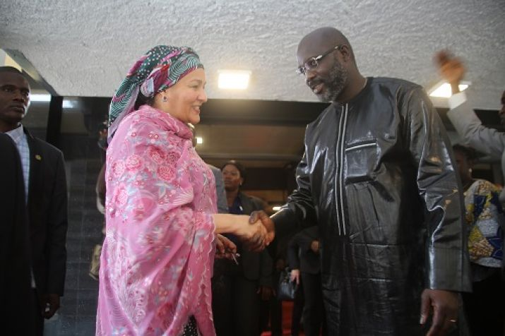 Madame Amina Mohammed shakes hand with President Weah
