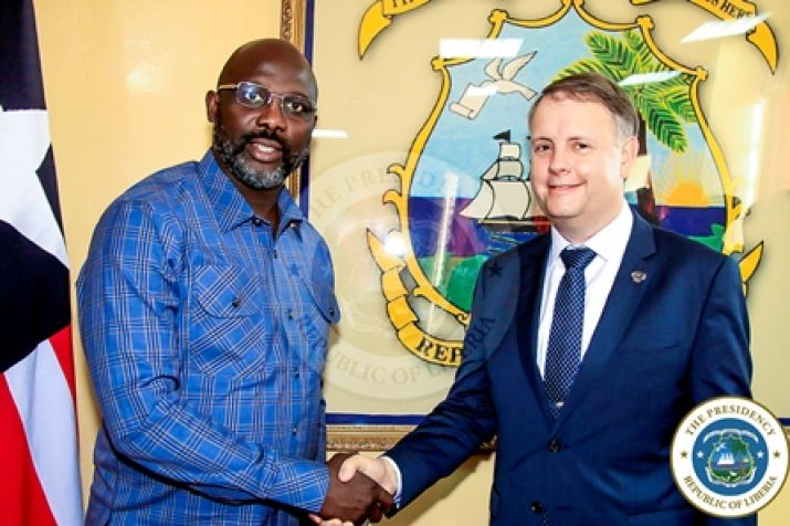 Pres. Weah, Mr. Palmer shake hands