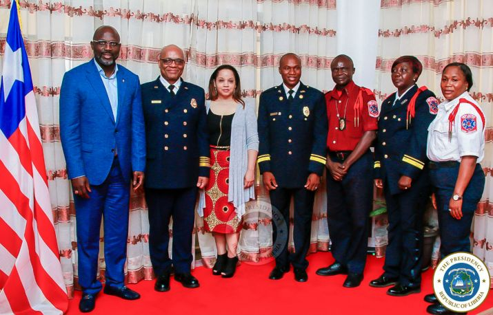 President Weah and Liberian Fire Service Leaders pose with US Fire Marshall and his wife following the meeting
