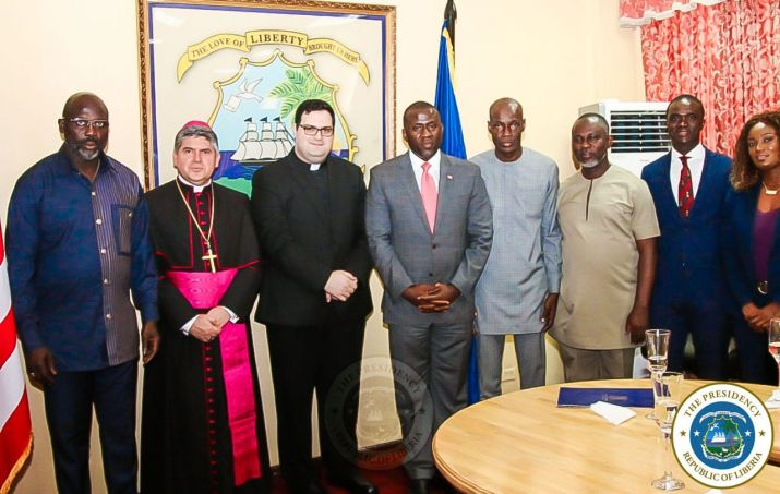 President Weah and Officials pose with Apostolic Nuncio and team
