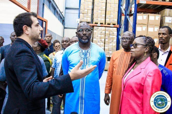 President Weah and delegation listen to the Supply chain mechanism instituted at the CMS Warehouse in Caldwell