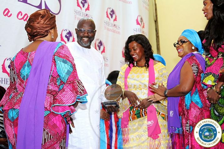 President Weah flanked by First Lady Clar Weah receiving 'He for She' Sheroes Award at the Sheroes Conference in Monrovia