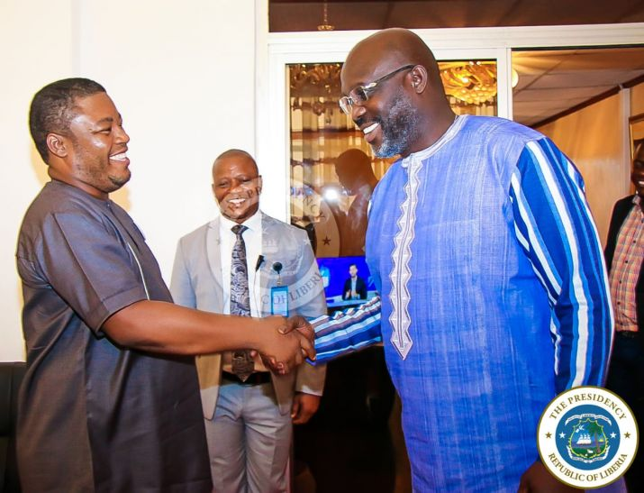 President Weah greets Representative-Elect Edward Papay Flomo at his Foreign Affairs office
