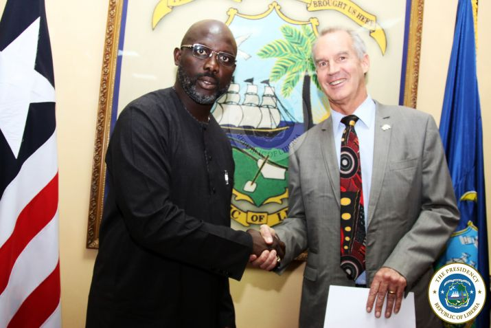 President Weah pose with the Ambassador of Australia, H E Andrew Barnes