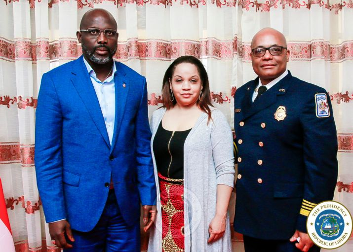 President Weah poses with US Fire Marshall and Mrs. Butler (US Fire Marshall Wife)