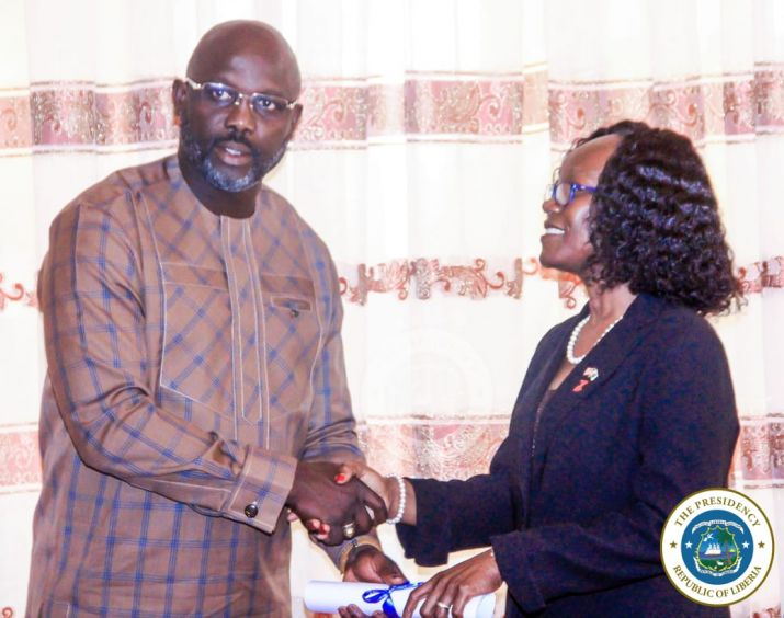 President Weah presents certificate of office to Amb Gurly Teta Gibson during her commissioning ceremony at the MOFA