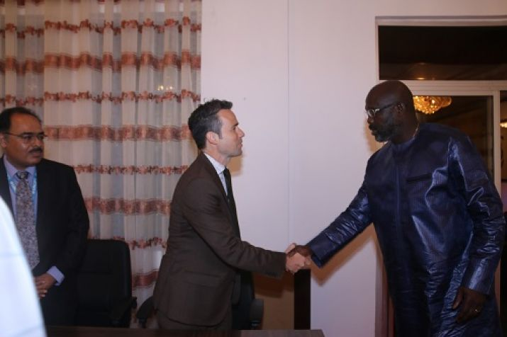 President Weah shakes hand with Mr. Ary Bobrow, Country Director of UNOPS
