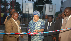President Sirleaf cuts the ribbon to the Electric Power sub-station in Paynesville.