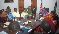 President Ellen Johnson Sirleaf and Vice President Joseph Boakai in discussions with executives of the Liberia Marketing Association.