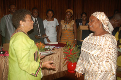 President Sirleaf presents a certificate to a female retiree at the Foreign Ministry in Monrovia.