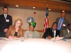 Lands, Mines & Energy Minister, Dr. Eugene Shannon and US Trade and Development Agency Director, Thelma Askey signing the agreement.