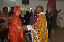 Apostolic Administrator of the Monrovia Diocese, Rev. Father Andrew Karnley meets President Sirleaf upon arrival at the Thanksgiving Mass.