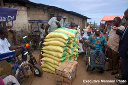 Assistant Chief of Staff for Logistics, Mr. Varney Sirleaf presents rice and cartons of fish to disabled on President's behalf.