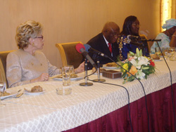 Vice President Boakai addresses forum as Senegalese First Lady Viviane Wade (seatedright) and Sierra Leonean First Lady seated left, look on.