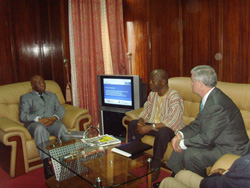 Vice President Joseph Boakai, NEC Chairman James Fromoyan, and a member of the IFES delegation hold meetings at the Capitol Building in Monrovia.